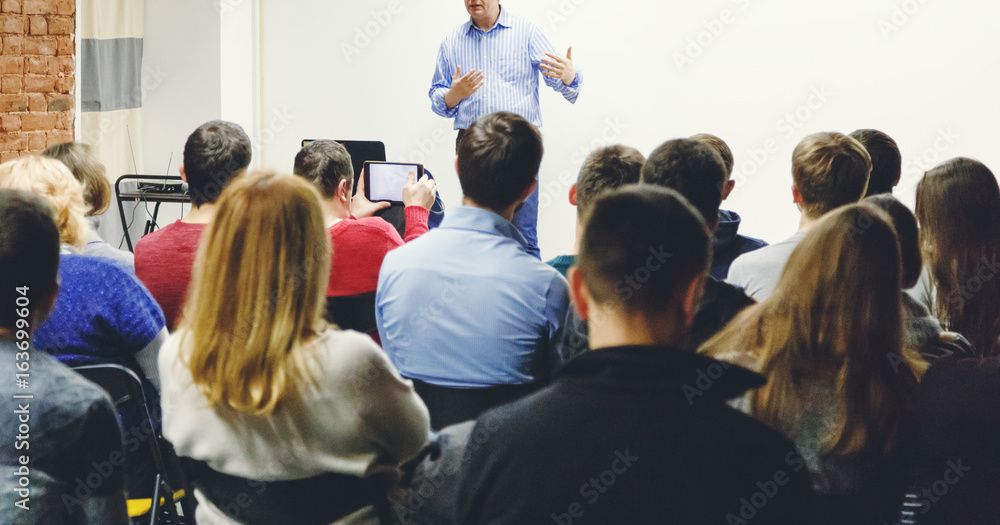 Fototapety, obrazy: Adult students listen to professor's lecture in small class room. Panoramic aspect ratio.