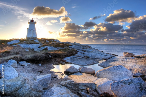 The Terence Bay lighthouse in Nova Scotia in the sunrise. Poster