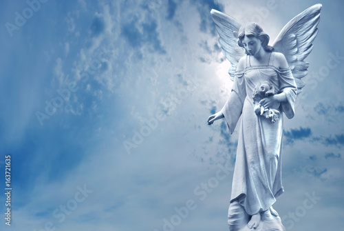 Foto  Guardian Angel sculpture over bright sky