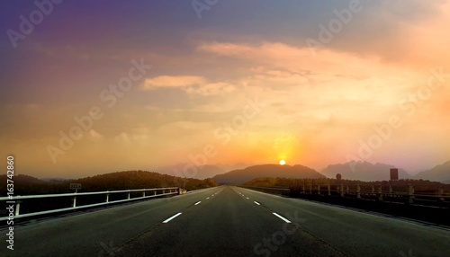 Canvas Print Empty open road during sunset