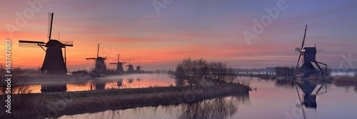 Fotografie, Obraz  Traditional windmills at sunrise, Kinderdijk, The Netherlands