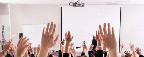 Photo Large group of seminar audience in class room