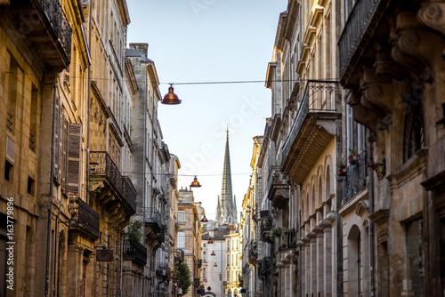 Deurstickers Havana Beautiful morning street view with old buildings and tower of saint Michel cathedral in Bordeaux city, France
