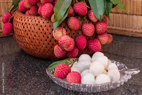 Fresh juicy lychee fruit on a glass plate. Organic leechee sweet fruit.