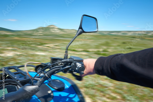 Riding on a quad bike in motion
