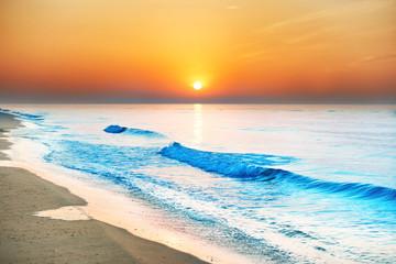 Panel Szklany Do łazienki Sunset on the beach with long coastline