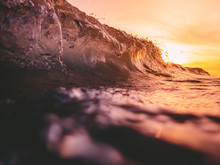 Wave In Ocean And Warm Sun Light. Sunset And Wave