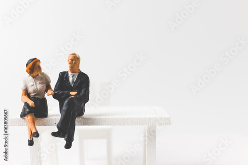 Fotografie, Obraz  Miniature people business concept sitting on chair with a space for text