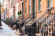 Row of old historic brownstone buildings in the Greenwich Village neighborhood of Manhattan, New York City NYC