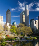Central Park spring landscape scene with crowds of people relaxing in Manhattan, New York City