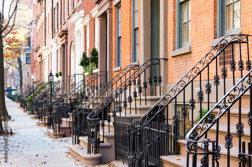 Row of old historic brownstone buildings in the Greenwich Village neighborhood of Manhattan, New York City NYC © deberarr