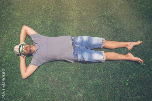 Fotografie, Obraz  Man lying on green grass