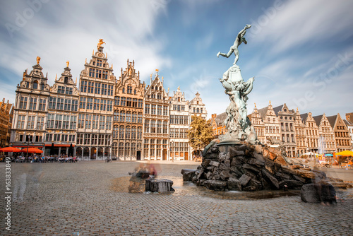 Canvas Prints Antwerp Wide angle view on the Grote Markt square with Brabo fountain in Atwerpen city, Belgium. Long exposure image technic with motion blurred people and clouds