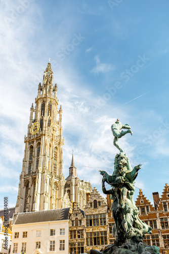 Poster Antwerp View on the beautiful buildings with fountain sculpture and church tower in the center of Antwerpen city in Belgium