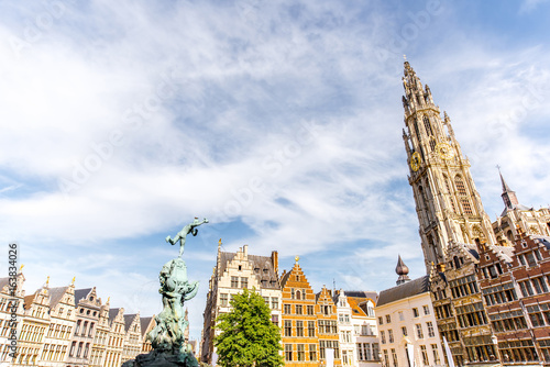 In de dag Antwerpen View on the beautiful buildings with fountain sculpture and church tower in the center of Antwerpen city in Belgium