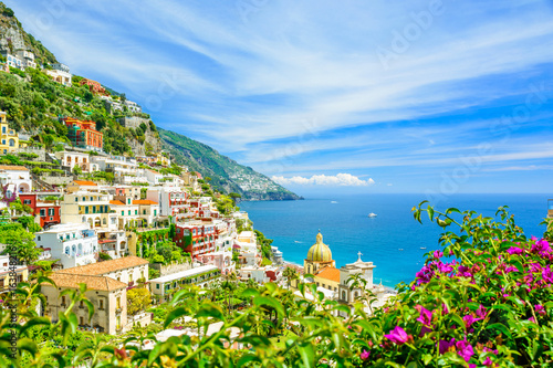 beautiful view on Positano on Amalfi coast with blurred flowers on foreground Canvas Print