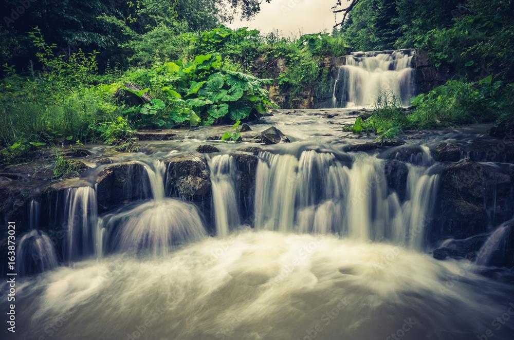 Waterfall in Wierchomla, Beskid Sadecki mountain range in Polish Carpathian Mountains