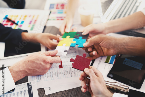 Fototapety, obrazy: Team of businessmen work together to build a puzzle. Concept of unity and partnership