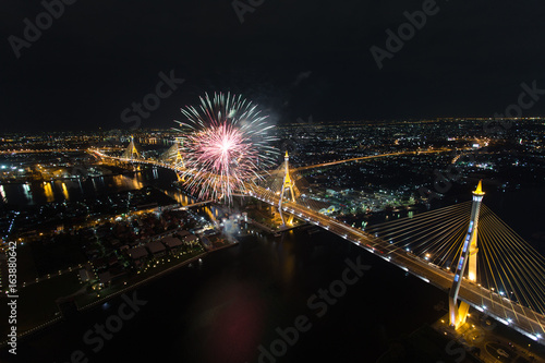 Night Scene at Bhumibol Bridge with fireworks in Bangkok Poster