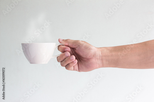 man hand with warm cup