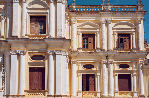 Con. Antique Windows and walls of colonial style building in India