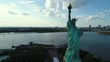 Aerial drone orbit Statue of Liberty reveal New York City