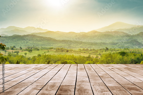 Fototapeta wooden table top with the mountain landscape obraz