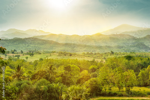 view of mountain landscape and sunlight
