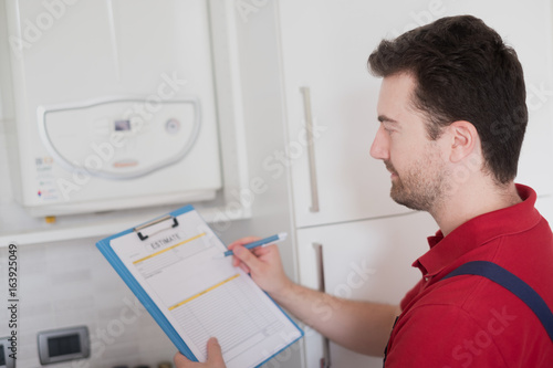 Valokuva  Plumber  control check on the home water boiler