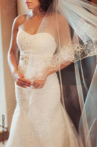 4eb0792b9fab Fashionable bridesmaids dresses helped wear bow on back of wedding dress  bride. Morning wedding day.