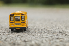 School Bus Yellow Toy On Asphalt Road