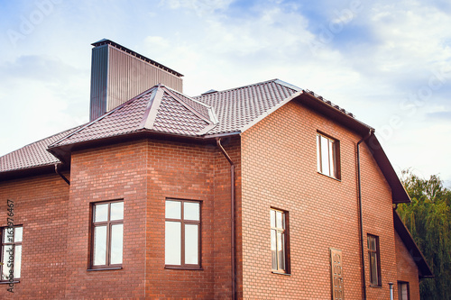 A Large Country House Made Of Red Brick With Tiled Roof The Concept
