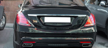 Back View Of Big Luxury Expensive Sedan Car Trunk. Black Colored. LED Red Tail Lights . Empty License Plate With Place For Text
