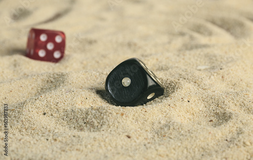 some dices in the sand dunes плакат