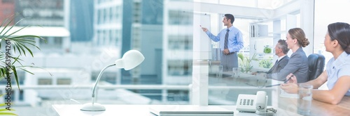 Obraz Business people having a meeting with office transition effect - fototapety do salonu