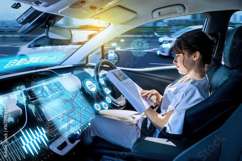 young woman reading a magazine in a autonomous car