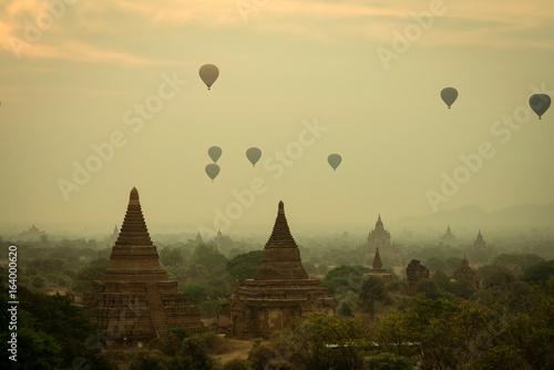 Fotobehang Zwavel geel Bagan pagoda sunrise morning time with balloon air in Bagan Mandalay Myanmar