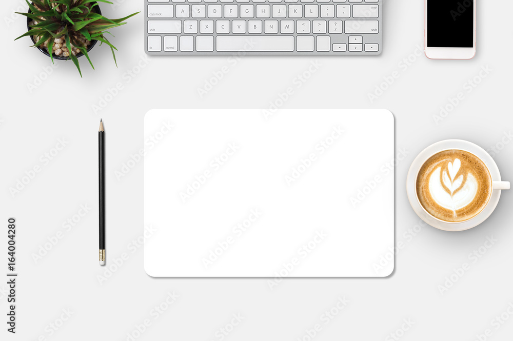 Fototapety, obrazy: Modern workplace with notebook, smartphone, blank paper, coffee up, pencil and little tree copy space on gray background. Top view. Flat lay style.