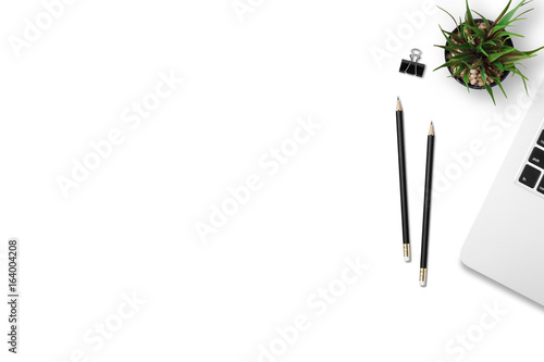 Fotografie, Obraz  Modern workplace with notebook, pencil and tree copy space on gray background