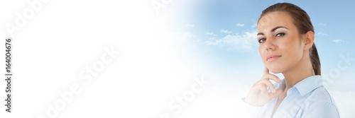 Fototapeta Thinking woman with sky transition obraz na płótnie