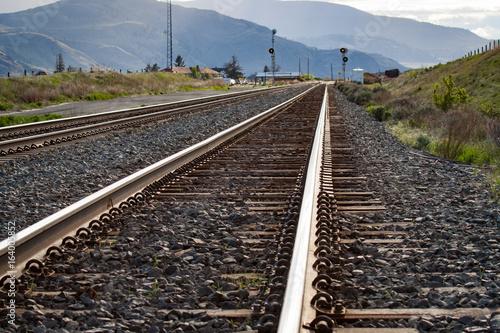 Papiers peints Voies ferrées Rails with Concrete Ties Stretching Off to Distance