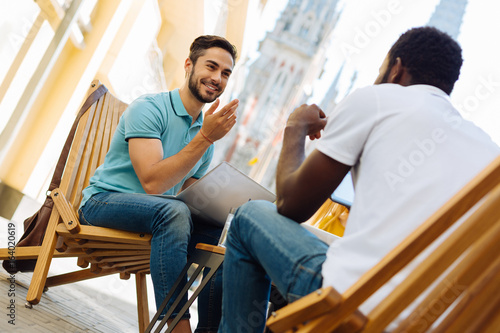 Fotografie, Obraz  Cheerful ambitious man convincing his colleague