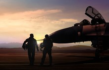 Military Aircraft And Pilot  At Airfield In Silhouette Scene