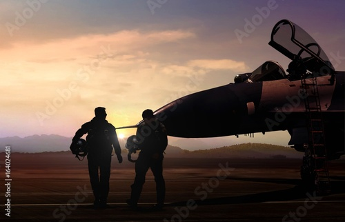 Military Aircraft and pilot  at airfield in silhouette scene Fotobehang