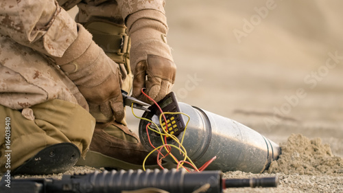 Close-up shot of Soldier Defusing a Bomb by Cutting a Wire During Military Opera Canvas Print