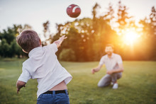 Dad With Son Playing American Football
