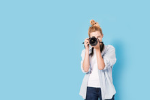 Young Blonde Photographer Is T...