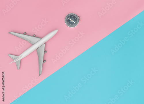 toy-plane-with-compass-for-colorful-chic-travel-concept-with-pin-and-blue-pastel-copy-space