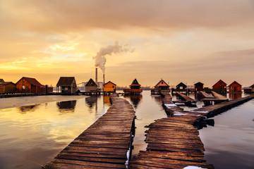 Fototapeta Wschód / zachód słońca Sunset lake Bokod with pier