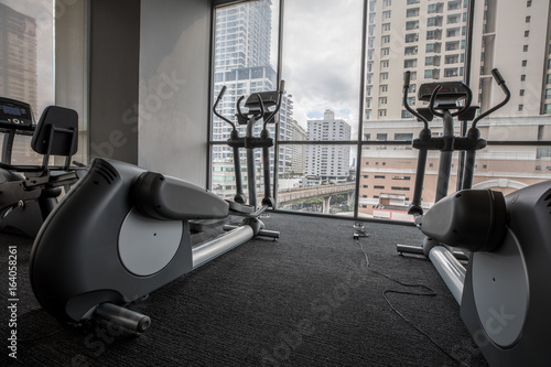 Elliptical in fitness room gym with city background buy this